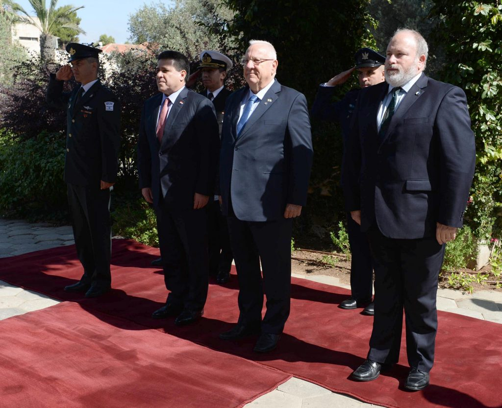 President Reuven Rivlin (second from right, front row) rolls out the red carpet for Paraguayan President Horacio Manuel Cartes Jara (on Rivlin's right), at the president's residence on Monday. (Mark Neyman/GPO)