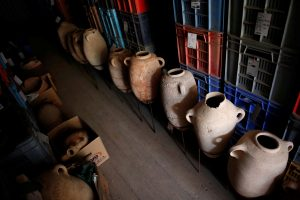 Clay jars are seen in a container after they were unearthed during excavation works at the first-ever-discovered Philistine cemetery at Ashkelon National Park in southern Israel, June 28. (Reuters/Amir Cohen)