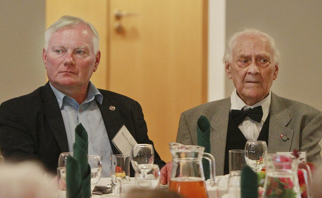 Ryszard Zielinski, 85, (R), a Pole who helped to save Jews during World War II, attends a luncheon, accompanied by his son Mieszko, in Warsaw on Sunday. (AP Photo/Czarek Sokolowski)