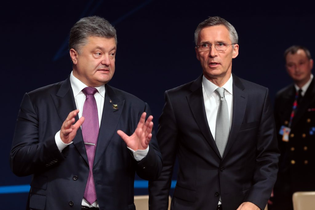 NATO Secretary General Jens Stoltenberg and Ukraine's President Petro Poroshenko to a working session of the NATO-Ukraine Commission at the NATO summit in Warsaw, Poland, Saturday, July 9, 2016. U.S. President Barack Obama and other NATO leaders have begun the second day of a summit meeting in Warsaw that's expected to lead to decisions about Afghanistan, the central Mediterranean and Iraq. (AP Photo/Markus Schreiber)