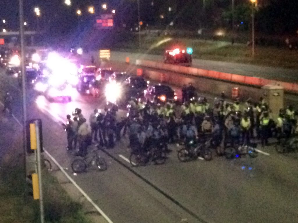 Law enforcement form a line across Interstate 94 on Saturday, July 9, 2016, in St. Paul, Minn., in response to protesters who blocked the highway. (AP Photo/Skip Foreman)