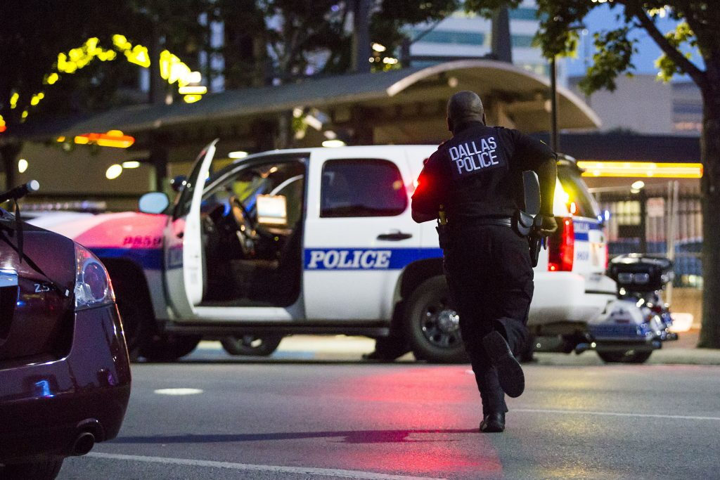 Dallas Police respond after shots were fired at a Black Lives Matter protest in downtown Dallas on Thursday evening. (Smiley N. Pool/The Dallas Morning News)