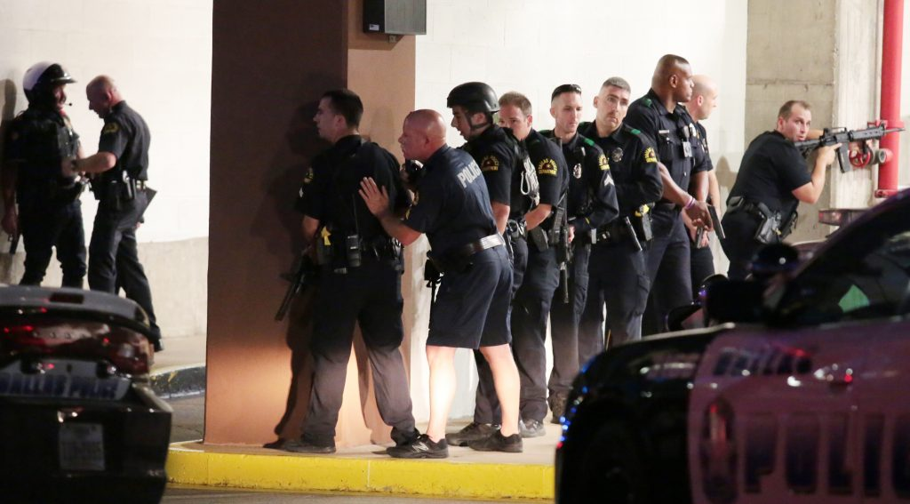 Dallas Police respond after shots were fired during a Black Lives Matter protest in Dallas on Thursday evening. (Maria R. Olivas/The Dallas Morning News via AP)