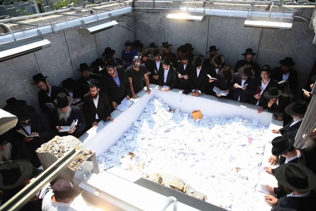 "People daven on Friday at the tziyun of the Lubavitcher Rebbe, Harav Menachem Mendel Schneerson, zt""l, at Old Montefiore Cemetery in Queens, ahead of his 22nd yahrtzeit on Shabbos. An estimated 50,000 people visited the tziyun over the weekend. (Bentzi Sasson/Chabad.org)"