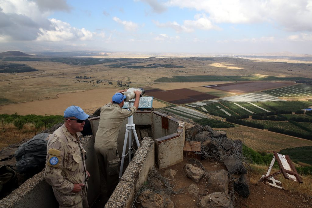 A UN observer is seen atop Mount Bental on the Israeli side of the border with Syria close to the city of Quneitra. (Yossi Zamir/Flash90)