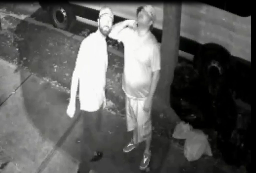 In this screencap made from security-camera video provided by the NYPD, the two suspects are seen on the street.
