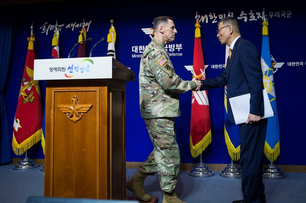 South Korean Defense Ministry's Deputy Minister Yoo Jeh-seung (R) shakes hands with the commander of U.S. Forces Korea's Eighth Army Lieutenant General Thomas Vandal after a news conference about deploying the Terminal High Altitude Area Defense (THAAD) anti-missile system, at the Defense Ministry in Seoul, South Korea, July 8, 2016. You Seung-kwan/News1 via REUTERS ATTENTION EDITORS - THIS IMAGE HAS BEEN SUPPLIED BY A THIRD PARTY. SOUTH KOREA OUT. FOR EDITORIAL USE ONLY. NO RESALES. NO ARCHIVE.