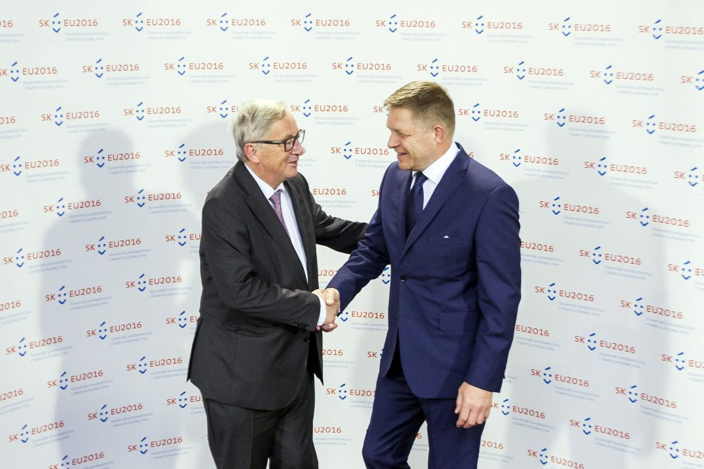 Slovakia's Prime Minister Robert Fico, right, and President of the European commission Jean-Claude Juncker, left, shake hands, during an informal meeting prior to a dinner hosted by Robert Fico at Bratislava Castle, Slovakia, Thursday, June 30, 2016. Slovakia takes over the European Union's presidency on Friday determined to help reconnect the EU with its citizens and put decision-making back in the hands of Europe's nations as the bloc reels from Britain's vote to leave. (AP Photo/Bundas Engler)