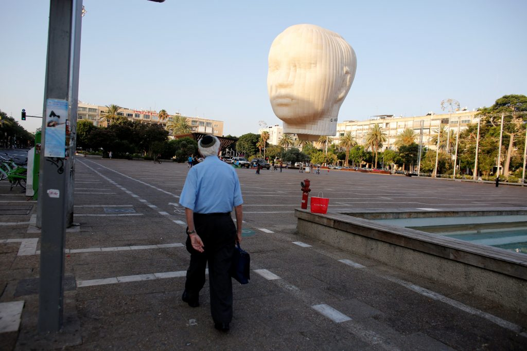 An artwork by Swedish artist Peter Helbom of a hot air ballon in the shape of a head can be seen on display at the Rabin square in Tel Aviv, Wednesday. (Reuters/Nir Elias)