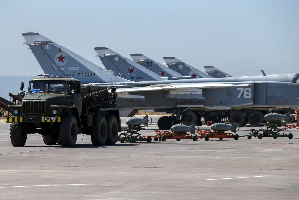 Russian fighter jets and bombers are parked at Hemeimeem air base in Syria last month. (Vadim Savitsky/Russian Defense Ministry Press Service pool photo via AP, File)