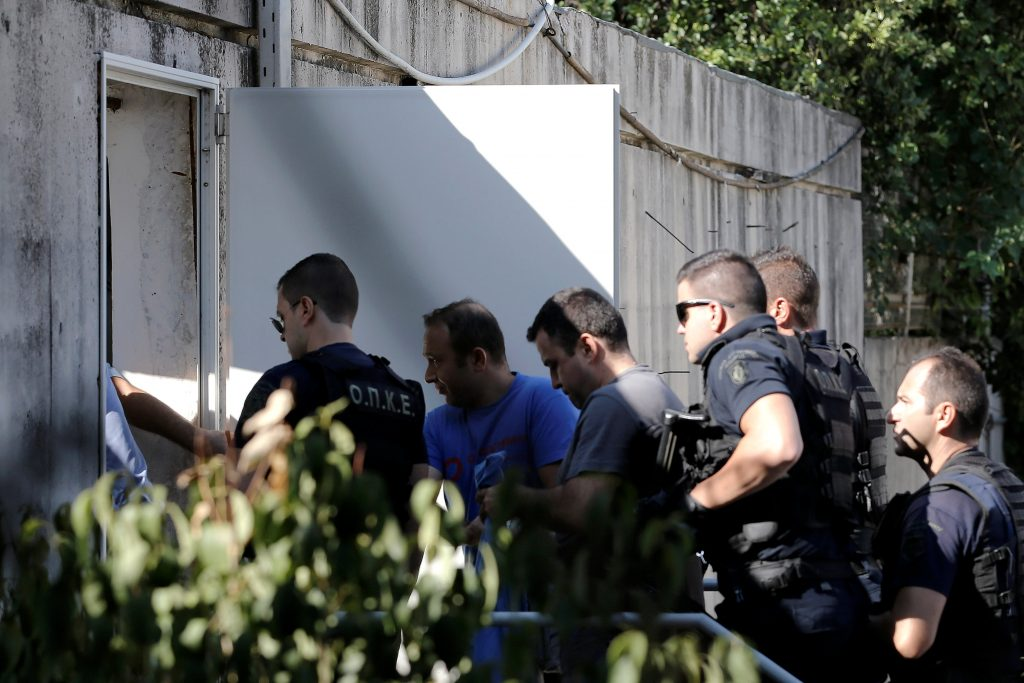 Two of the eight Turkish soldiers (C), who fled to Greece in a helicopter and requested political asylum after a failed military coup against the government, is escorted by special police forces after the postponement of their interviews for asylum request at the Asylum Service in Athens, Greece, July 27, 2016. REUTERS/Alkis Konstantinidis