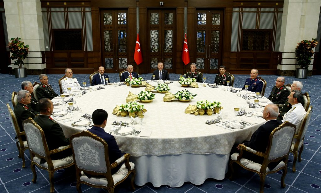 Turkey's President Tayyip Erdogan (C) meets with Turkey's Prime Minister Binali Yildirim (8th L), Chief of Staff General Hulusi Akar (7th R) and the members of High Military Council around a dinner table at the Presidential Palace in Ankara, Turkey, July 28, 2016. Kayhan Ozer/Presidential Palace/Handout via REUTERS ATTENTION EDITORS - THIS PICTURE WAS PROVIDED BY A THIRD PARTY. FOR EDITORIAL USE ONLY. NO RESALES. NO ARCHIVE. TPX IMAGES OF THE DAY