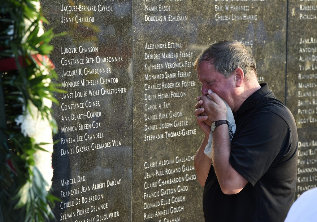 Chris Rhoads, who was the general manager of Flight Attendants for TWA, cries Sunday at the memorial wall during the 20th anniversary of the TWA Flight 800 crash in Shirley, N.Y. (AP Photo/Kathy Kmonicek)