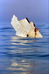 In this July 18, 1996, photo, a piece of debris from TWA Flight 800 floats in the Atlantic Ocean off Long Island the day after the Boeing 747, carrying 230 people, exploded in a ball of fire, killing everyone on board. (John Levy/ AFP via AP, Pool, File)