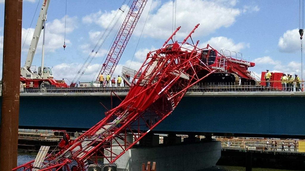 A giant crane sits on the Tappan Zee Bridge after toppling around noon on Tuesday. (David Leibstein via AP)