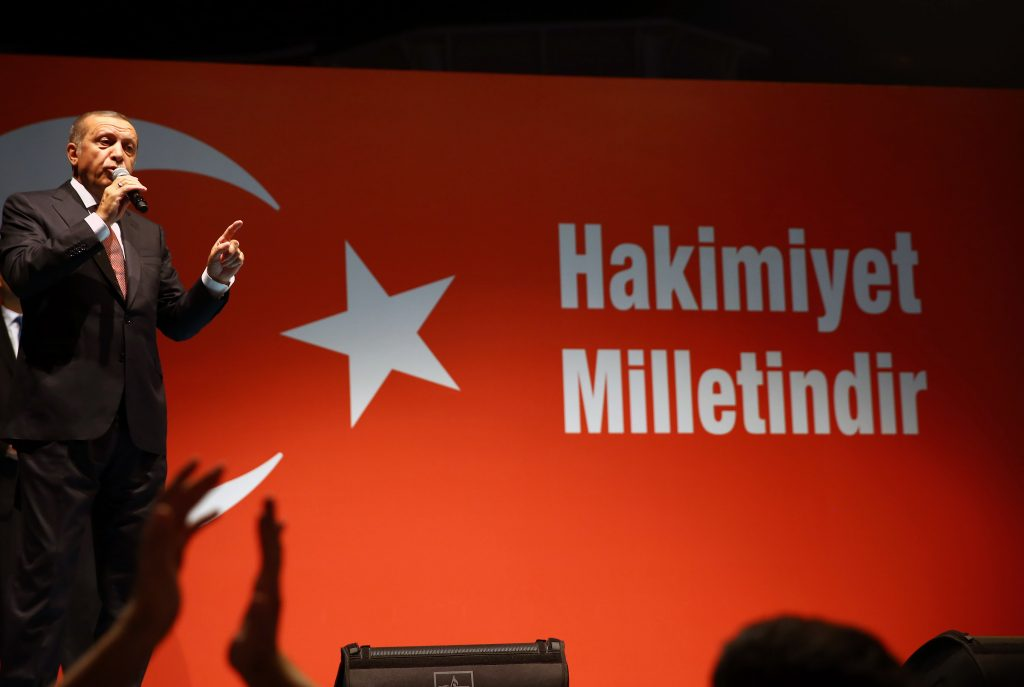 Turkey's President Recep Tayyip Erdogan addresses supporters gathered in front of his residence in Istanbul on Tuesday. (AP Photo/Kayhan Ozer, Presidential Press Service, Pool)