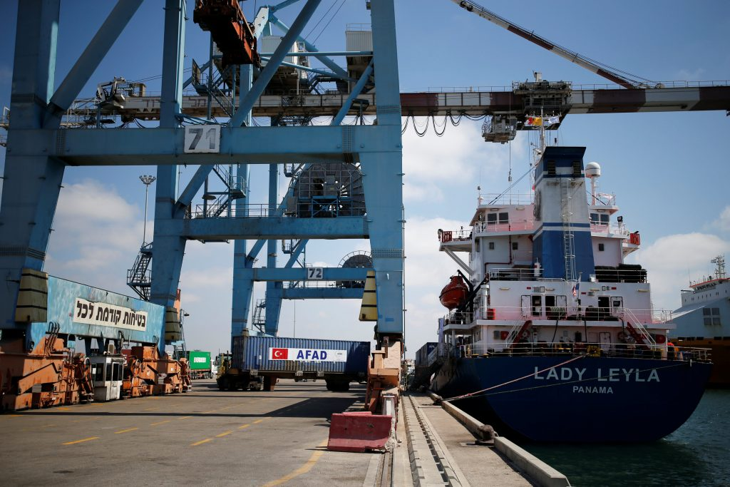Containers are unloaded from the Panama-flagged Lady Leyla, a Turkish ship carrying humanitarian aid to Gaza, at the Ashdod port, in southern Israel July 3, 2016. REUTERS/Amir Cohen