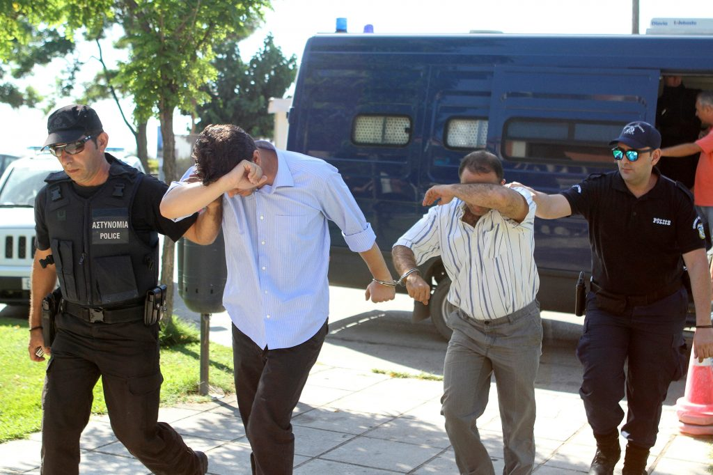 Two of the eight Turkish soldiers who fled to Greece in a helicopter and requested political asylum after a failed military coup against the government, are brought to prosecutor by two policemen in the northern Greek city of Alexandroupolis, Greece, July 17, 2016. REUTERS/Giannis Moisiadis/Intimenews GREECE OUT. NO COMMERCIAL OR EDITORIAL SALES IN GREECE