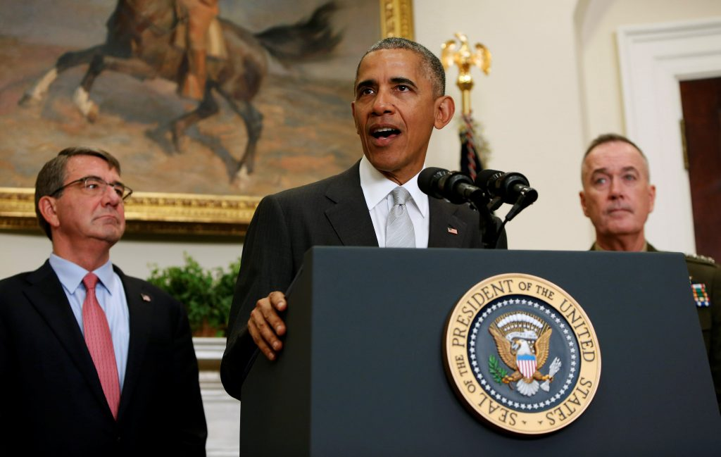 U.S. President Barack Obama, surrounded by U.S. Secretary of Defense Ash Carter (L) and the Chairman of the Joint Chiefs of Staff USMC General Joseph Dunford, Jr., (R) delivers a statement from the Roosevelt Room on Afghanistan at the White House in Washington U.S. July 6, 2016. JREUTERS/Gary Cameron