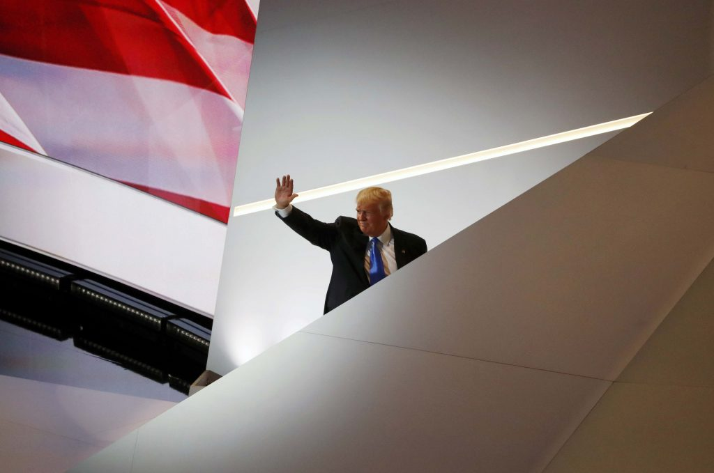 Republican U.S. presidential candidate Donald Trump waves as he leaves the stage at the Republican National Convention in Cleveland, Ohio, U.S. July 18, 2016. REUTERS/Aaron P. Bernstein