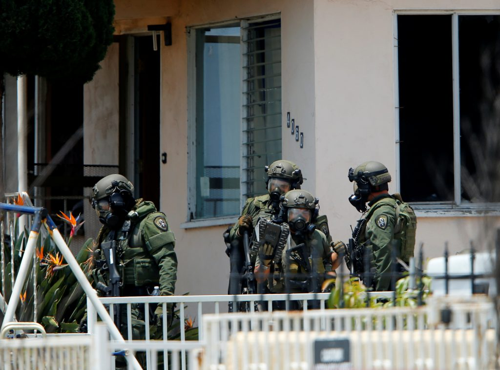 A police SWAT team leaves a home they had surrounded while searching for a second suspect after a San Diego police officer was fatally shot and another was wounded late on Thursday, in San Diego, California, United States July 29, 2016. REUTERS/Mike Blake