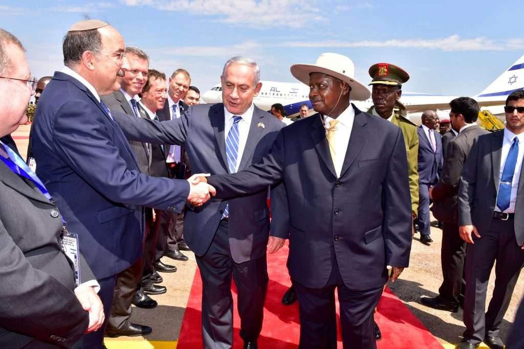 Israeli Prime Minister Binyamin Netanyahu (C) introduces Foreign Ministry director general Dore Gold (L) to Uganda's President Yoweri Museveni at the Entebbe airport in Uganda on Monday. (Presidential Press Unit/Handout via Reuters)