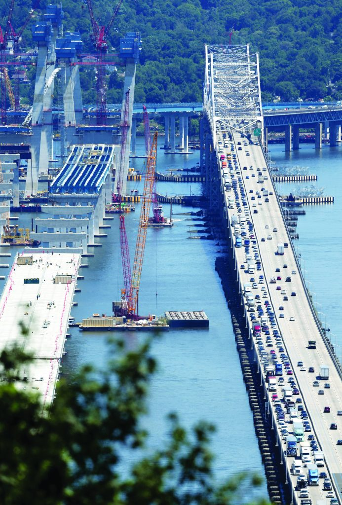 Traffic moves slowly on Wednesday across the Tappan Zee Bridge (R) while construction continues on the new bridge (L). (AP Photo/Seth Wenig)
