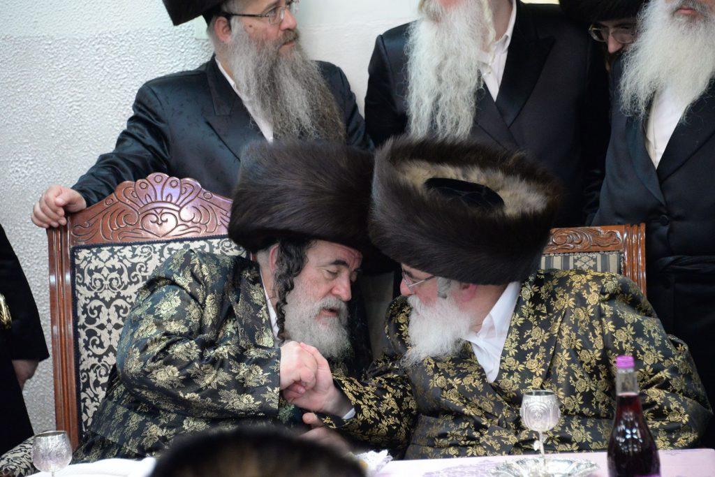 The Rebbes wish each other lchaim at the yahrtzeit seudah. (JDN)