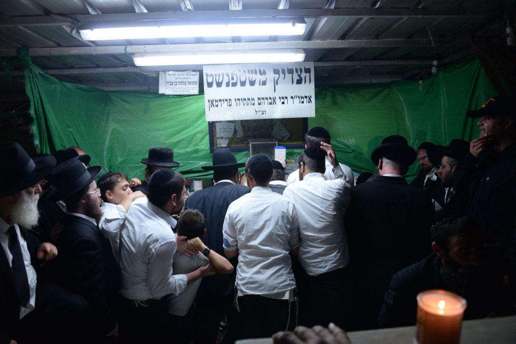 "Tefillos at the kever of the Stefanest Rebbe, Harav Avraham Matisyahu Friedman, zy""a, at the Nachalat Yitzchak cemetery in Givatayim. (JDN)"