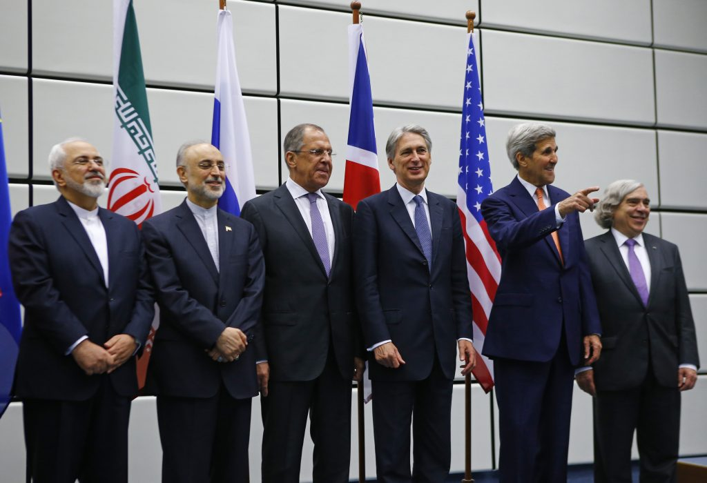 Iranian Foreign Minister Mohammad Javad Zarif, Iranian ambassador to IAEA Ali Akbar Salehi, Russian Foreign Minister Sergey Lavrov, British Secretary of State for Foreign and Commonwealth Affairs Philip Hammond, U.S. Secretary of State John Kerry and U.S. Secretary of Energy Ernest Moniz (L-R) prepare for a family photo in Vienna, Austria 14 July, 2015. Six major powers seeking to negotiate an agreement to limit the Iranian nuclear programme concluded a meeting that lasted just over an hour on Tuesday, a U.S. official said. The official, who spoke on condition of anonymity, said Iran did not take part in the meeting. REUTERS/Leonhard Foeger (Newscom TagID: rtrlseven180820.jpg) [Photo via Newscom]