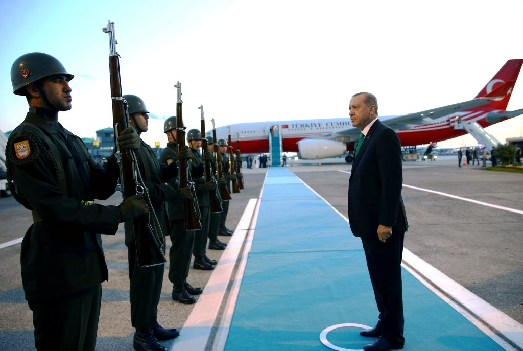 Turkish President Tayyip Erdogan reviews the guards of honour as he departs for Warsaw to attend a NATO summit, in Istanbul, Turkey, July 7, 2016. Picture taken July 7, 2016. Kayhan Ozer/Presidential Palace/Handout via REUTERS ATTENTION EDITORS - THIS PICTURE WAS PROVIDED BY A THIRD PARTY. FOR EDITORIAL USE ONLY. NO RESALES. NO ARCHIVE.