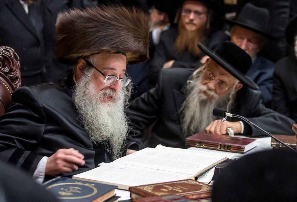 "Harav Shmuel Naftali Genger, zt""l (R) listening intently to, ybl""c, the Sanz-Klausenburger Rebbe, shlita. (Lenchevsky Brothers)"