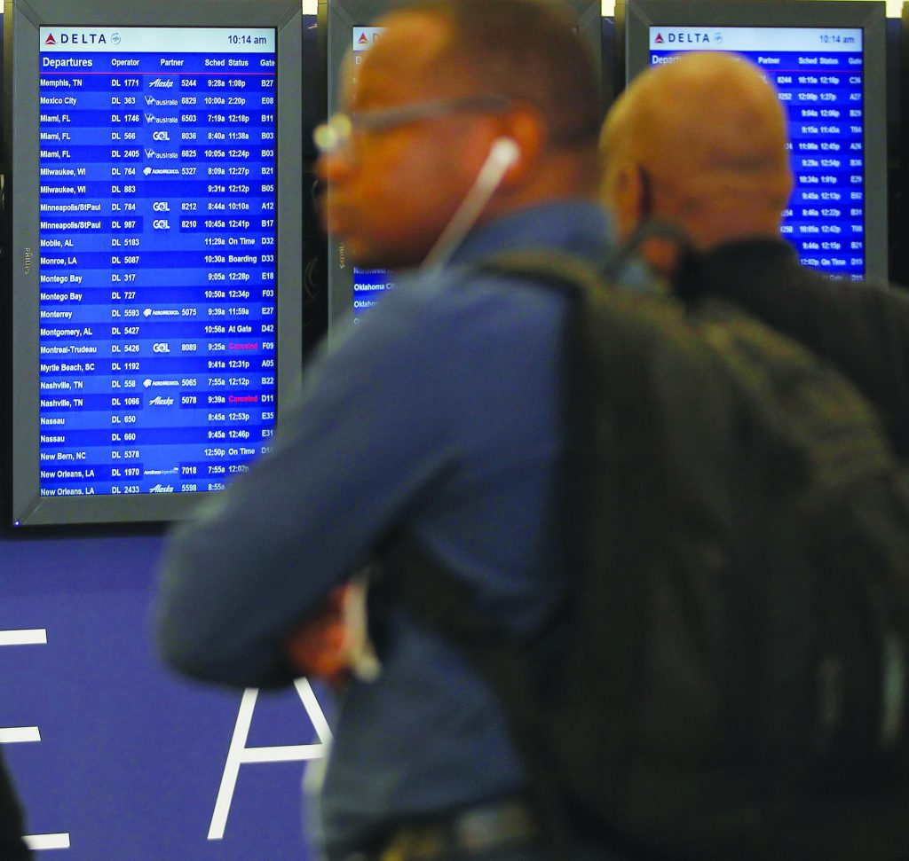 Departure boards show some Delta flights as cancelled flights after Delta Air Lines' computer systems crashed on Monday, grounding flights around the globe, at Hartsfield Jackson Atlanta International Airport in Atlanta, Georgia, U.S. August 8, 2016. REUTERS/Tami Chappell