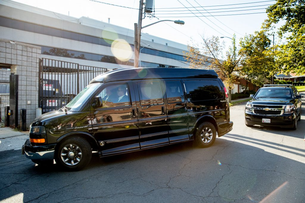The motorcade carrying Democratic presidential candidate Hillary Clinton arrives at an FBI office in White Plains, N.Y., Saturday, Aug. 27, 2016, for a national security briefing. (AP Photo/Andrew Harnik)