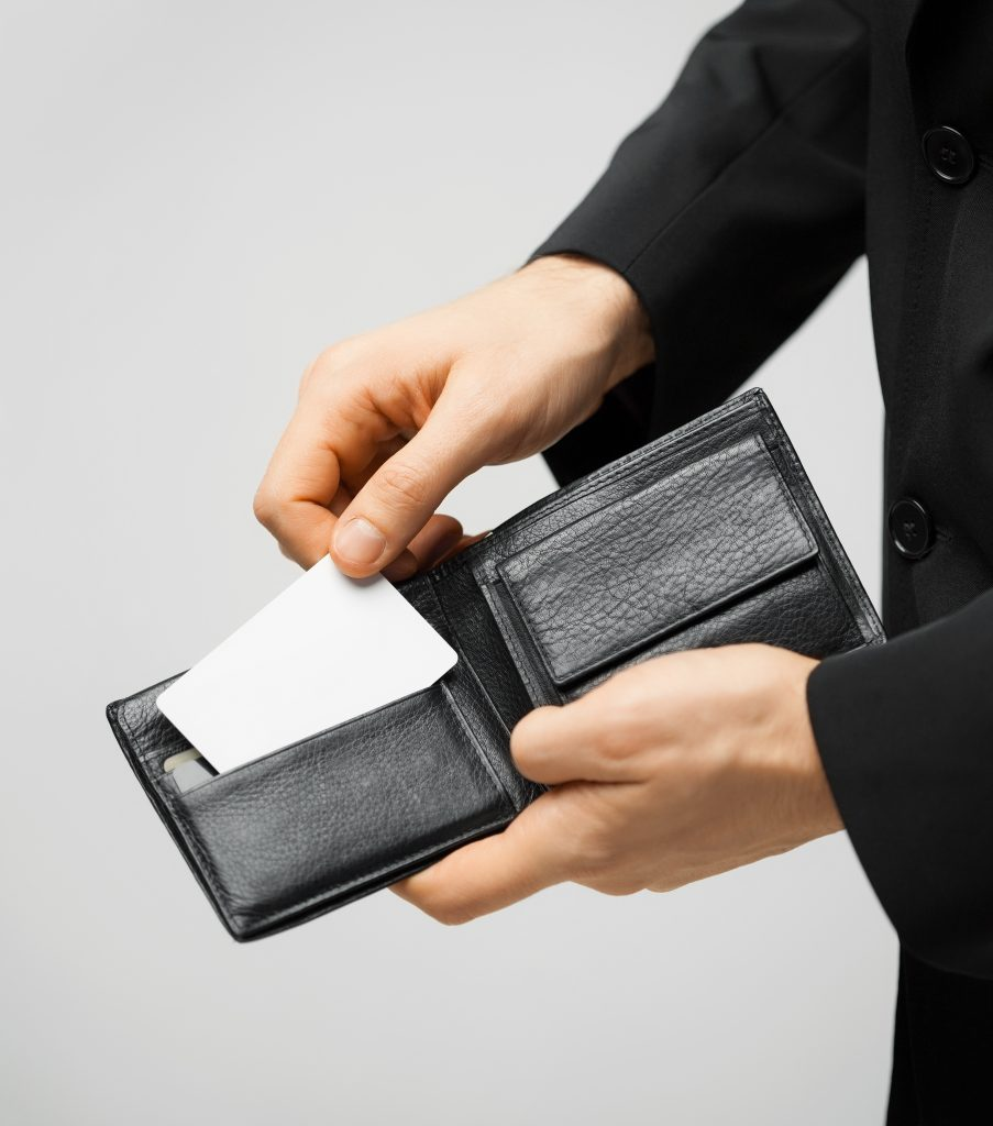 18229979 - man in suit with wallet and credit card