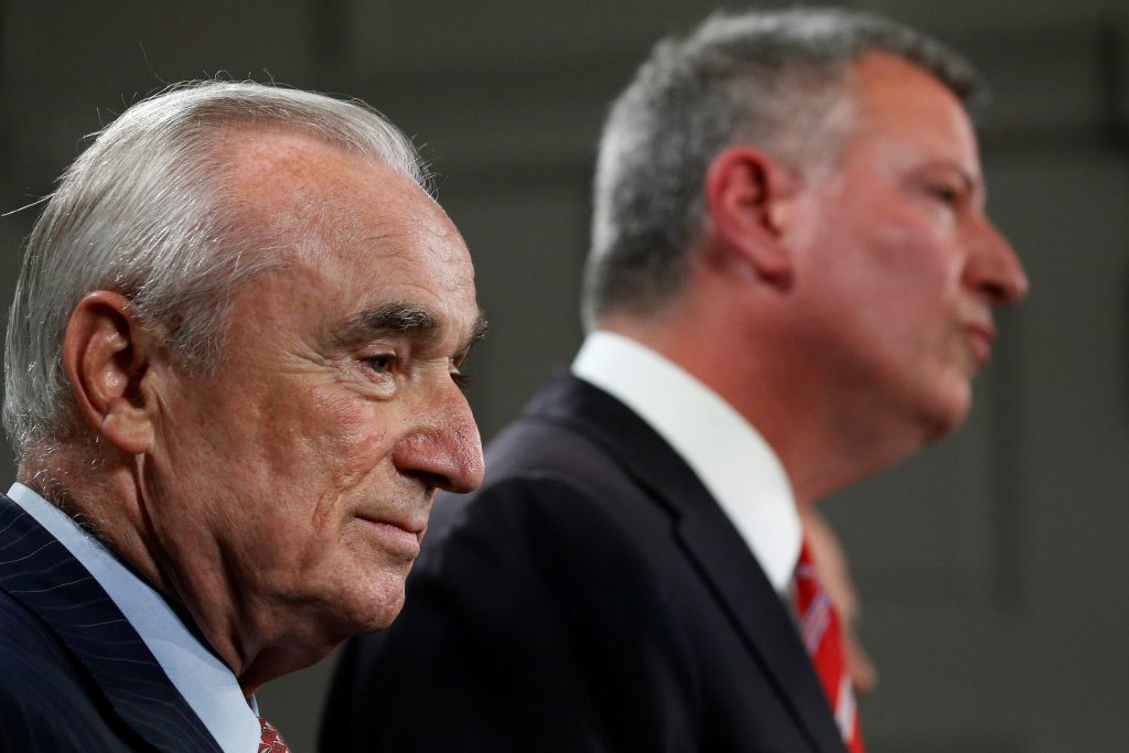 New York Police Commissioner William Bratton (L) is pictured while New York City Mayor Bill de Blasio (R) announces Bratton's retirement at City Hall in the Manhattan borough New York. (Carlo Allegri/Reuters)