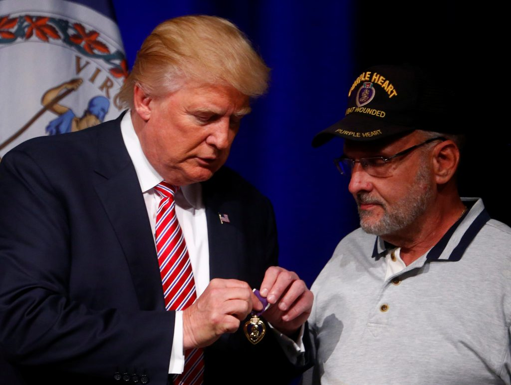 Presidential nominee Donald Trump talks to Lt. Col. Louis Dorfman, who gave Trump his Purple Heart, during a campaign event on Tuesday at Briar Woods High School in Ashburn, Virginia, U.S. (REUTERS/Eric Thayer Republican)