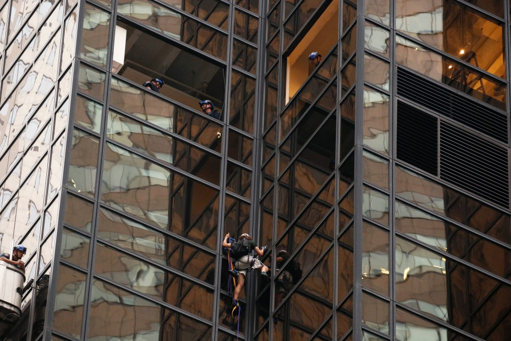 Officers from the NYPD monitor a man as he climbs the outside of Trump Tower in New York on Wednesday evening. (Reuters/Lucas Jackson)