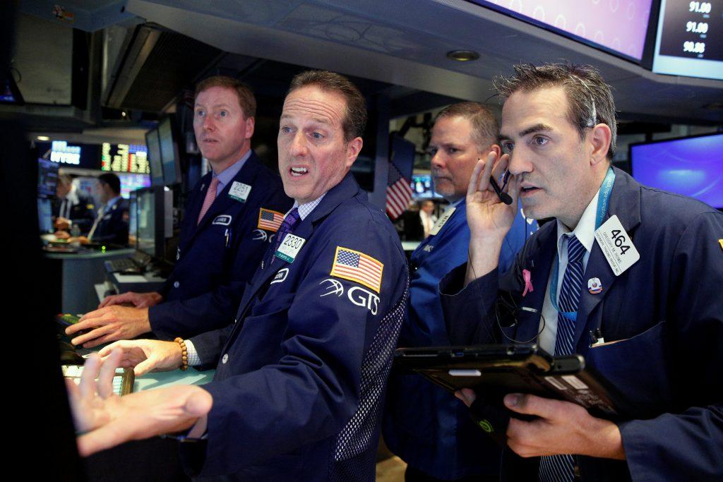 Traders work on the floor of the New York Stock Exchange on Wednesday. (Reuters/Brendan McDermid)