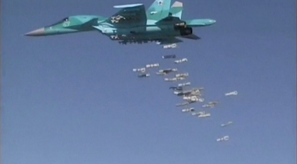 A still image, taken from video footage and released by Russia's Defence Ministry on August 18, 2016, shows a Russian Sukhoi Su-34 fighter-bomber based at Iran's Hamadan air base dropping off bombs in the Syrian province of Deir ez-Zor. Ministry of Defence of the Russian Federation/Handout via REUTERS TV ATTENTION EDITORS - THIS IMAGE WAS PROVIDED BY A THIRD PARTY. EDITORIAL USE ONLY. NO RESALES. NO ARCHIVES.