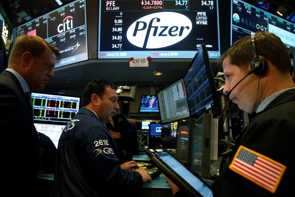 Traders at the Pfizer post on the floor of the New York Stock Exchange on Monday. (Reuters/Brendan McDermid)