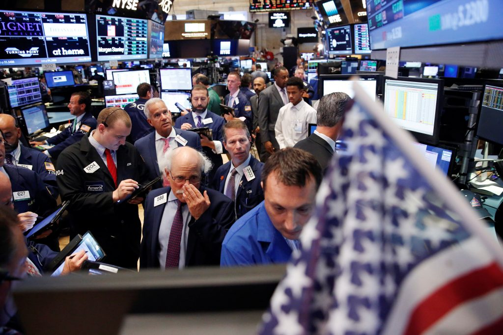 Traders work on the floor of the New York Stock Exchange on Tuesday. (Reuters/Lucas Jackson)