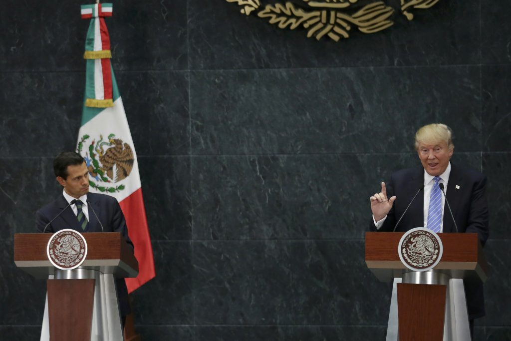 Donald Trump (R) and Mexico's President Enrique Pena Nieto give a press conference at the Los Pinos residence in Mexico City, on Wednesday. (Reuters/Henry Romero)