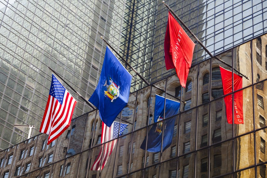 51344753 - new york city - june 22: grand hyatt hotel in manhattan with colorful flags on the facade on june 22, 2013