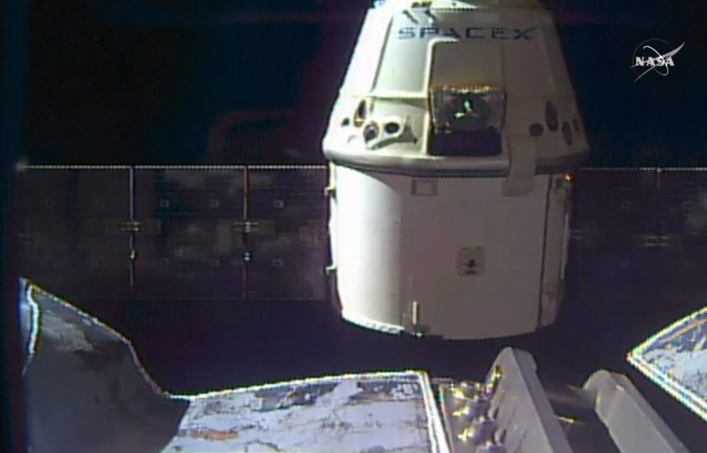 In this frame grab taken from NASA TV, a SpaceX Dragon capsule separates from a robotic arm of the International Space Station en route back to Earth with a load of science experiments and gear from the space station on Friday. (NASA via AP)
