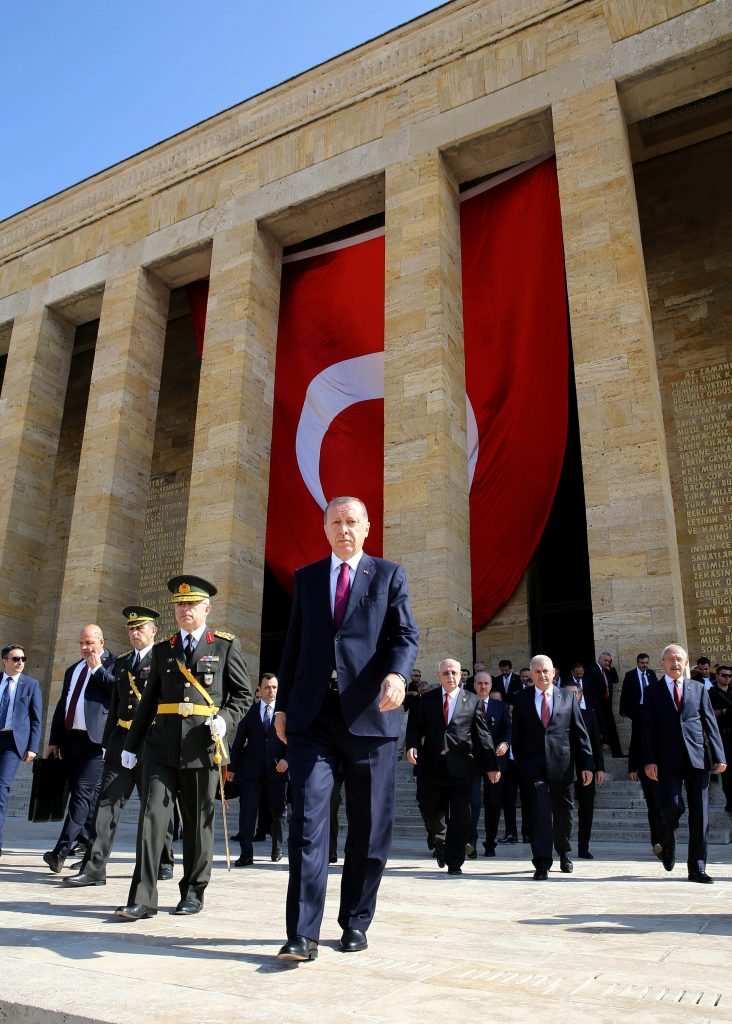 Turkish President Tayyip Erdogan attends a ceremony marking the 94th anniversary of Victory Day at the mausoleum of Mustafa Kemal Ataturk in Ankara, Turkey, on Tuesday. (Yasin Bulbul/Presidential Palace/Handout via Reuters).