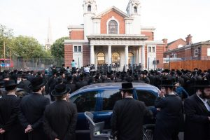 The overflow crowd on the street in front of the Bobov beis medrash. (JDN)