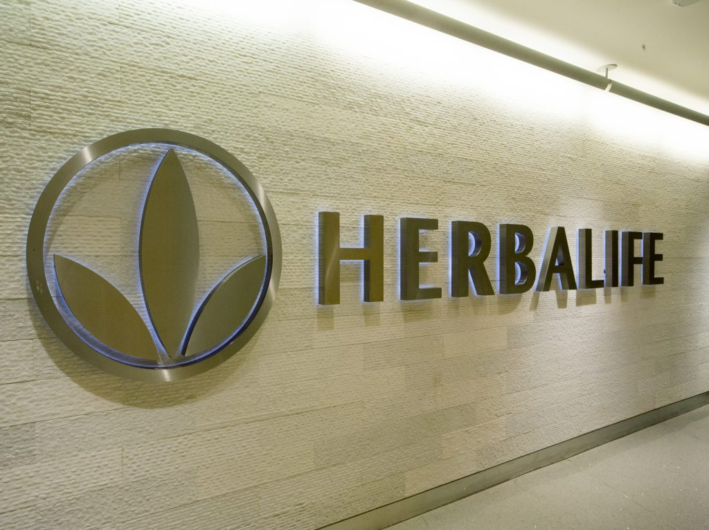 This Wednesday, May 11, 2016, photo shows the Herbalife logo at their corporate office in Los Angeles. Herbalife reports financial results Wednesday, Aug. 3, 2016. (AP Photo/Damian Dovarganes)