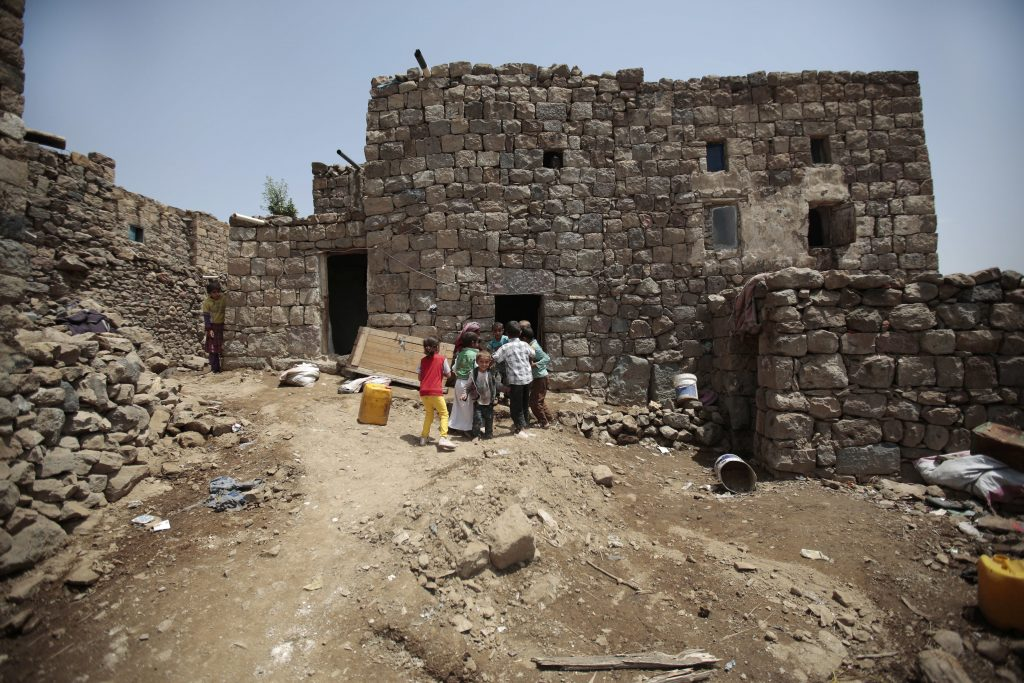 In this July, 25, 2016 photo, relatives of 10-year-old Youssef al-Salmi, who was killed when a bomb exploded while he was playing with it, play in front his house, in Hasn Faj Attan village, on the mountainous outskirts of Sanaa, Yemen. (AP Photo/Hani Mohammed)