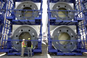 Over-sized racks holding sections of wind turbine towers at a staging site at Port of Providence. (AP Photo/Steven Senne)